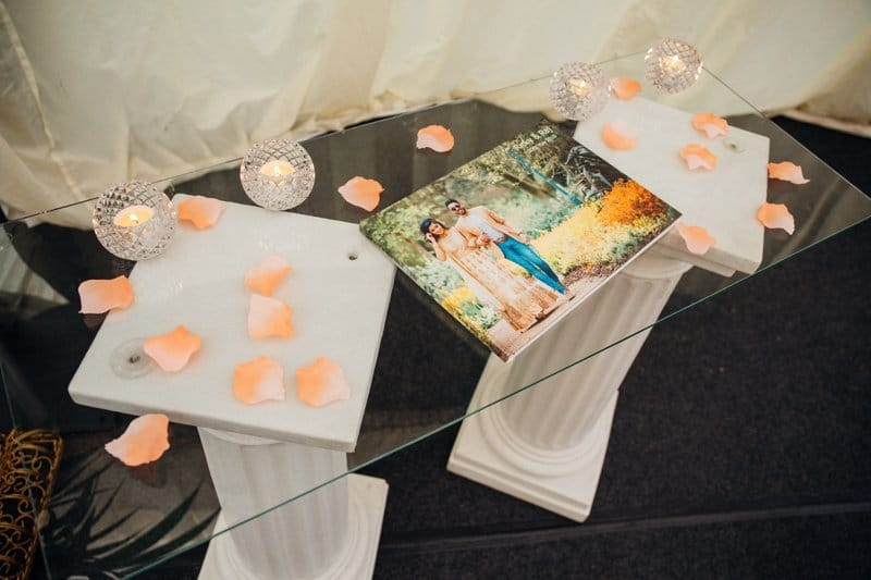 guest book displayed on glass table