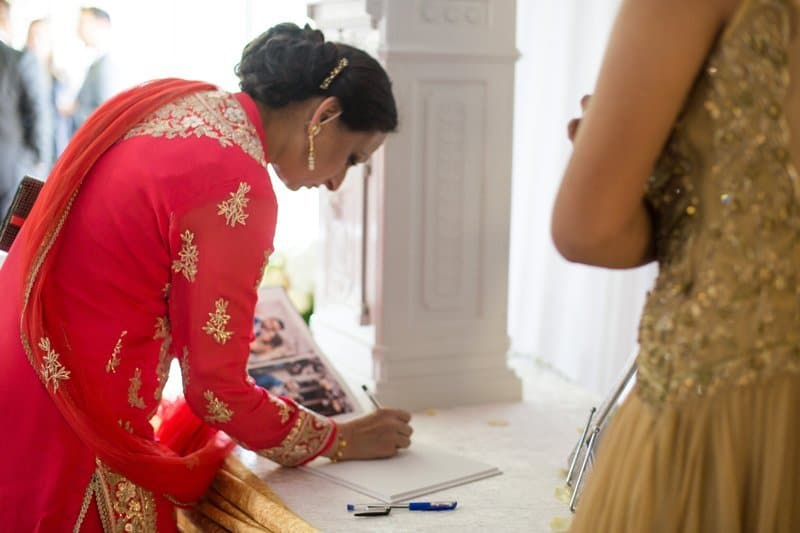 lady signing a guest book